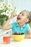 Cute Little girl  eating cherries Royalty Free Stock Photo