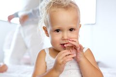 Cute little girl eating chocolate Royalty Free Stock Photo
