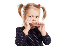 Cute little girl eating chocolate Royalty Free Stock Photography