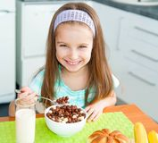 Little girl eating her breakfast Stock Photos