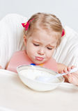 Cute little girl eating Royalty Free Stock Image