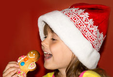 Cute little girl eating gingerbread Royalty Free Stock Photography