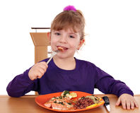 Cute little girl eating Royalty Free Stock Photos