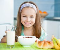 Little girl eating her breakfast Royalty Free Stock Photo