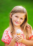 Cute little girl eating ice cream Royalty Free Stock Photography