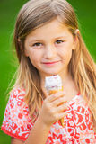 Cute little girl eating ice cream Stock Images