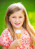Cute little girl eating ice cream Stock Image