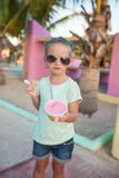 Cute little girl eating ice-cream outdoor Stock Images