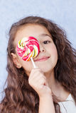 Cute little girl eating a lollipop Royalty Free Stock Photo