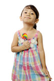 Cute Little Girl Eating Lollipop Stock Photo