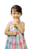 Cute Little Girl Eating Lollipop Royalty Free Stock Photo