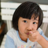 Cute little girl eating a lollipop Stock Photo