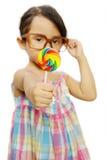 Cute Little Girl Eating Lollipop Royalty Free Stock Photos