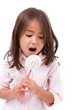 Cute little girl eating marshmallow sweet candy Royalty Free Stock Photos