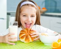 Little girl eating her breakfast Stock Photography