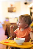 Cute little girl eating spaghetti at small restaurant stock photos