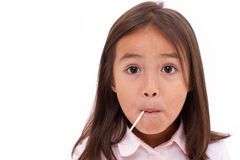 Cute little girl eating sweet candy Stock Photo