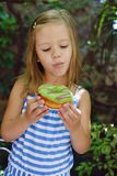 Girl eating donuts outdoors Royalty Free Stock Photography