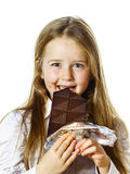 Cute little girl eating tablet of chocolate Stock Image