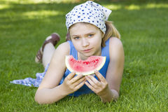 Cute little girl eating watermelon Stock Photography