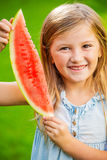 Cute little girl eating watermelon Stock Photos