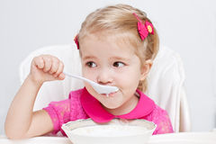 Cute little girl eats Royalty Free Stock Photos