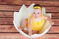 Cute little girl in the egg basket. View from above Royalty Free Stock Images