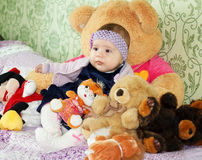 Cute little girl embraces toys Stock Photo