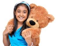 Cute little girl embracing teddy bear Stock Photos