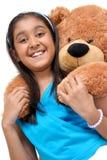 Cute little girl embracing teddy bear Stock Photo