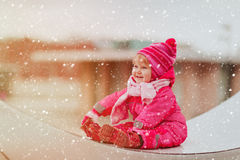 Cute little girl enjoy first snow in the city, winter fun Stock Photography