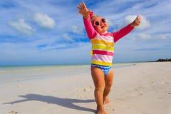 Cute little girl enjoy summer tropical beach Royalty Free Stock Photo