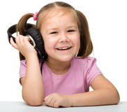 Cute little girl enjoying music using headphones Royalty Free Stock Photography