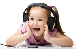 Cute little girl enjoying music using headphones Stock Image