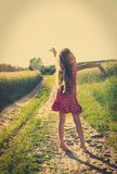 Cute little girl enjoying Nature. Freedom concept. Beauty Girl over Sky and Sun. Sunbeams. Royalty Free Stock Photo