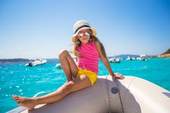 Cute little girl enjoying sailing on boat in the Royalty Free Stock Images