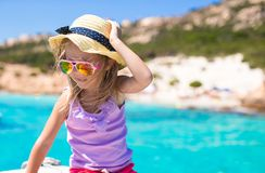 Cute little girl enjoying sailing on boat in the Stock Images