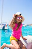 Cute little girl enjoying sailing on boat in the Stock Image