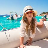Cute little girl enjoying sailing on boat in blue Stock Photography