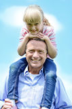 Cute little girl enjoying shoulder ride Royalty Free Stock Image