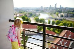 Cute little girl enjoying a view of Vilnius city from the Gediminas hill. Exploring tourist attractions with kids. Vilnius, Lithuania royalty free stock photo