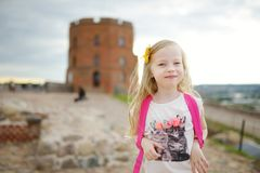 Cute little girl enjoying a view of Vilnius city from the Gediminas hill. Exploring tourist attractions with kids. Vilnius, Lithuania royalty free stock photography