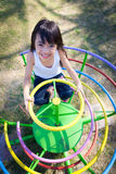 Cute little girl enjoys playing in a children Stock Image