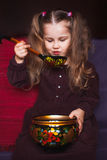 Cute little girl with ethnic dishes. Cute little girl with Russian  ethnic dishes Stock Photo
