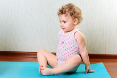 Cute little girl exercising in gym Royalty Free Stock Photo