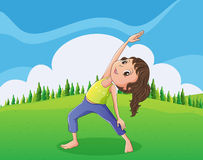 A cute little girl exercising at the hilltop Stock Photos
