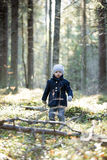 Cute Little Girl exploring autumn woods by spring stream. Stock Image
