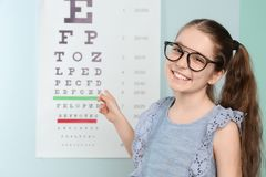 Cute little girl with eyeglasses in   office Royalty Free Stock Image