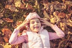 Cute little girl on fallen leaves. stock photography