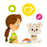 Cute little girl feed a puppy dog Royalty Free Stock Image